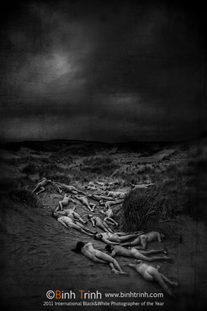 A group of people naked lying on Himitangi Beach by Binh Trinh