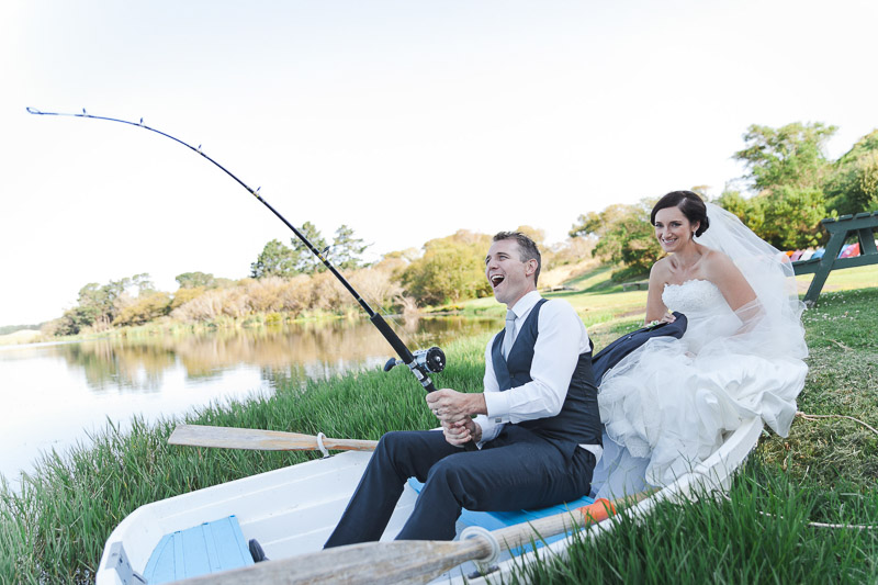 A fun Palmerston North wedding image by Binh Trinh with boat in a pond