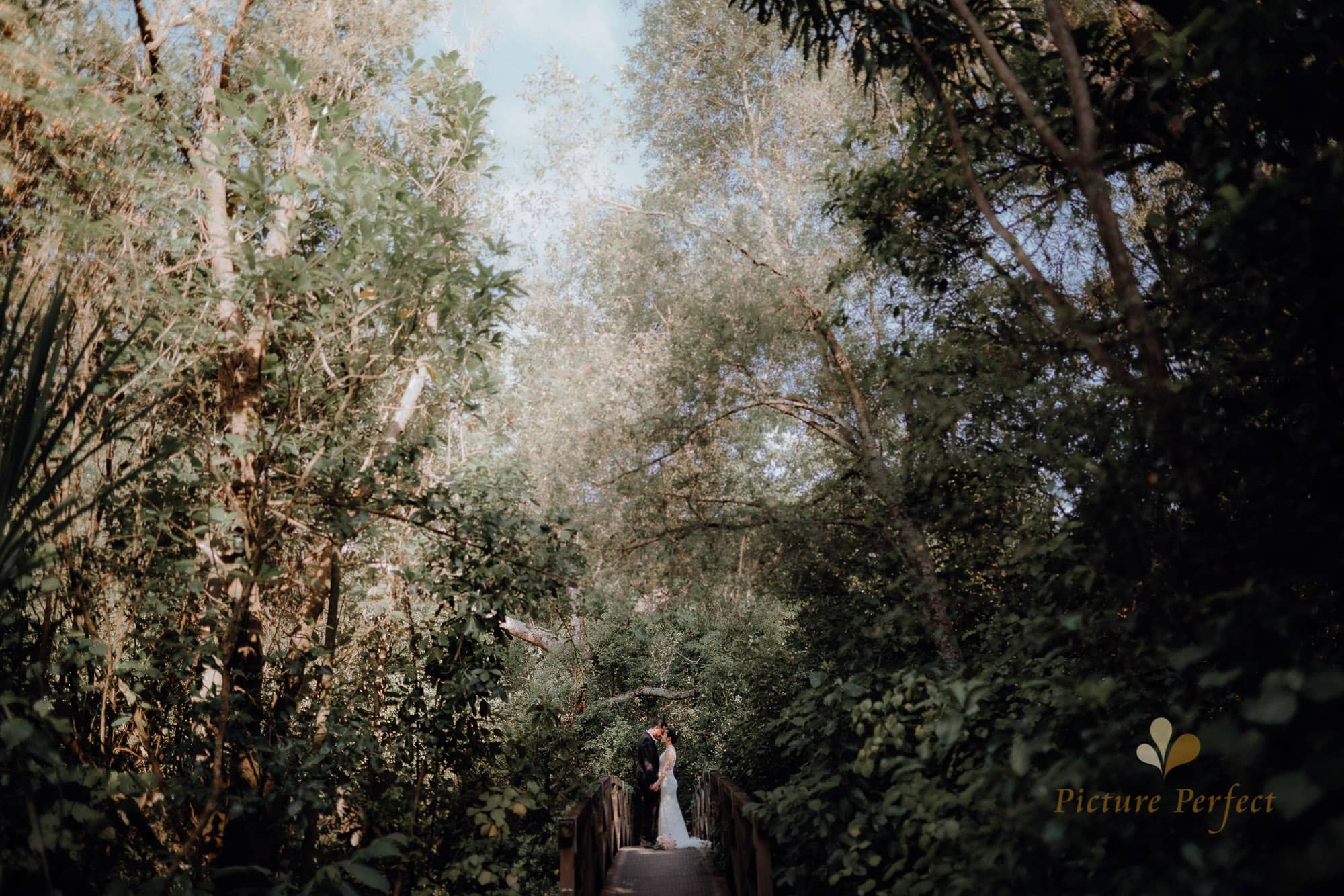 New Zealand photographer Binh Trinh with his natural intimate wedding image