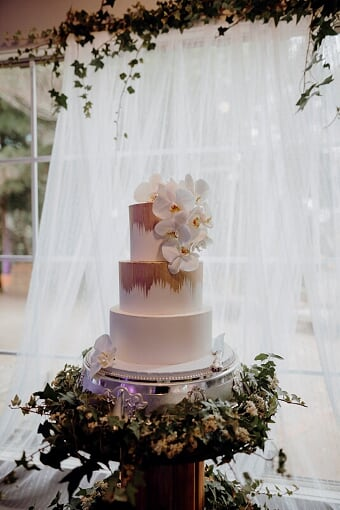 a wedding cake with intricate designs