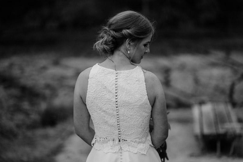 Classical wedding photography of bride on bridge