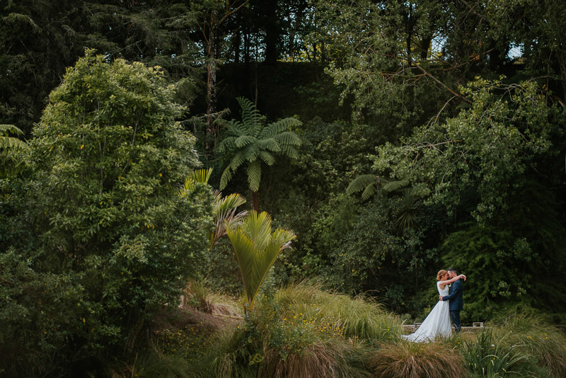 bride and groom kissing as they pose for their Whanganui wedding photo