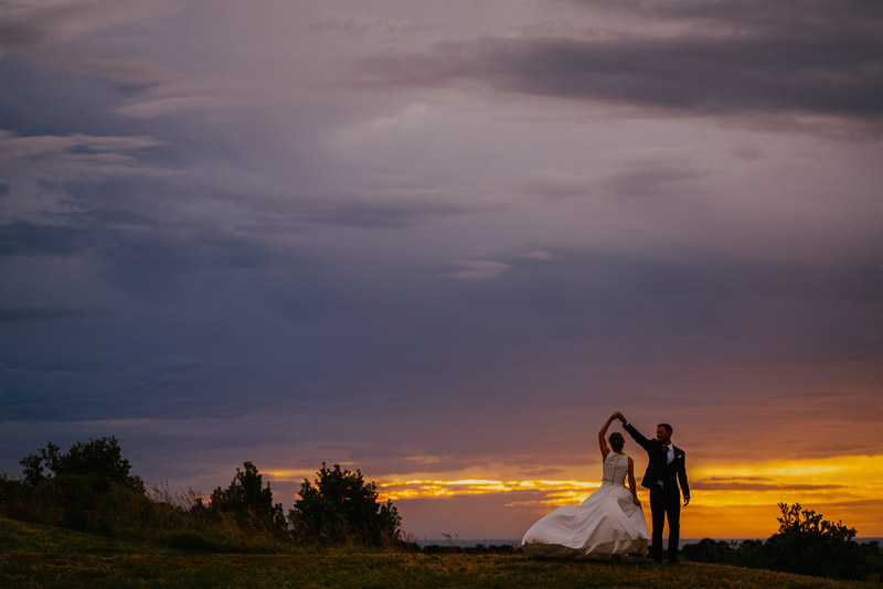 sunset wedding photo at Whanganui Golf Course during reception