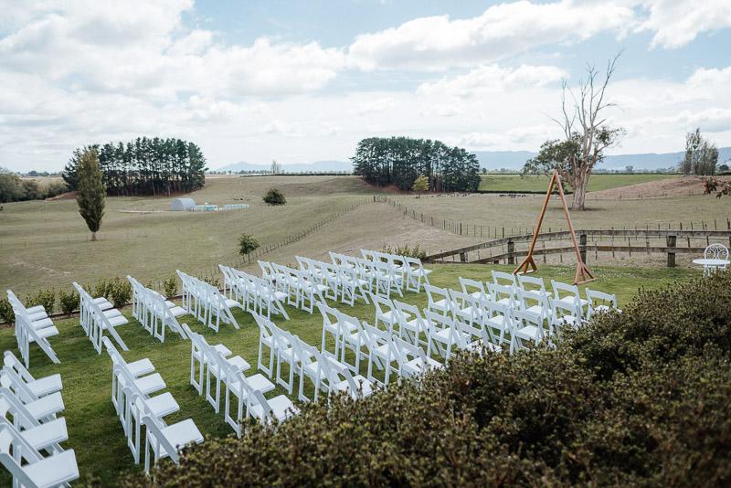 beautiful triangle wedding arch at farm wedding venue