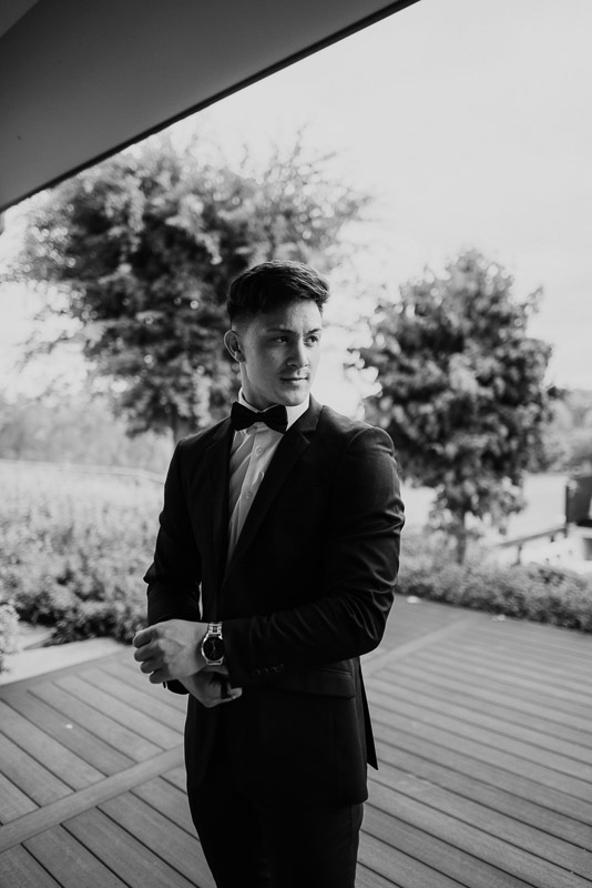 stunning black and white wedding photo of the groom