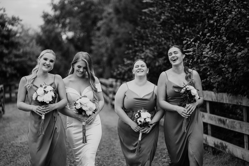 bride and her bridesmaid walking during the wedding photography session