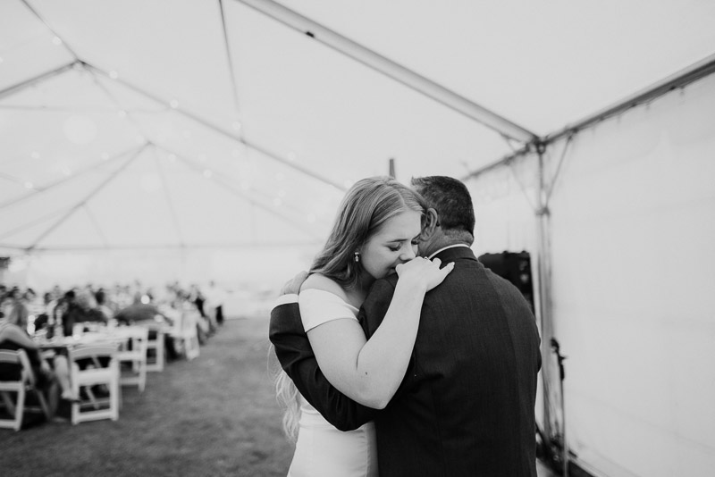 bride and father of the bride first dance during wedding reception