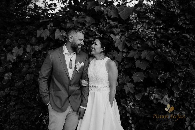 happy bride and groom posing for their whanganui wedding photography