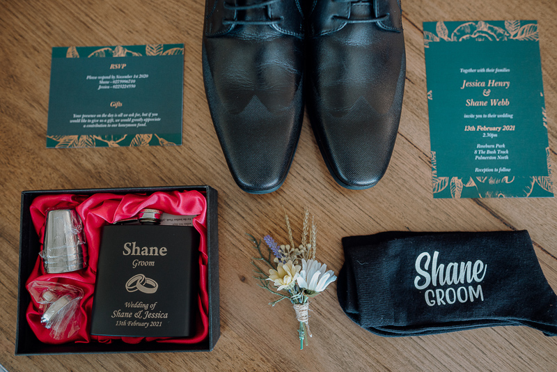 flat lay of groom accessories for wedding a roseburn park