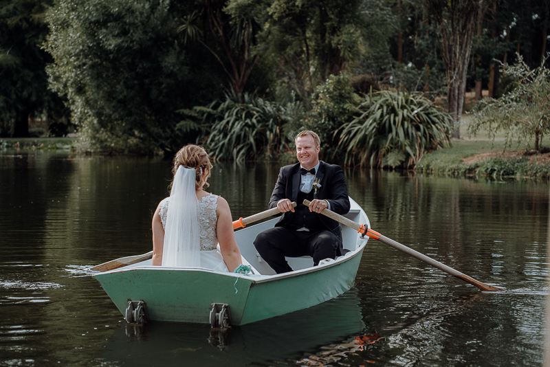 wedding film of bride and groom in a row boat at Roseburn Park